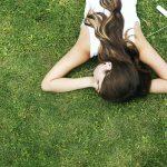Lady lying in grass